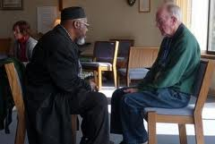 Two men listening compassionately